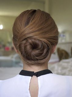 Twisting sophisticated hair bun → http://youtu.be/6-GofKymsXQ