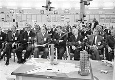 John F. Kennedy sits behind models of the Saturn rockets as he is briefed on this country's man-on-the-moon program in the Saturn control center at Cape Canaveral, Fla., Nov. 16, 1963. AP.