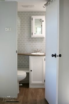 When giving a small space (like an R.) a makeover it is important to give the WHOLE space a makeover, that includes the bathroom! Vintage Bathroom Vanities, Master Bathroom Vanity, Bathroom Vanity Makeover, Bathroom Ideas, Bathroom Caulk, Bathroom Cabinets, Camper Interior Design, Trailer Decor, Rv Trailer