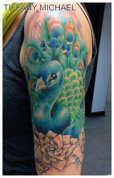 Peacock half sleeve tattoo