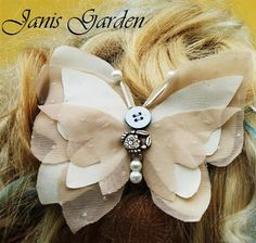 Photo collection accessories inspired '20s Butterfly hair clip, hand embroidered. realized with: - ivory taffetà material, treated to don t get frayed. - light pink strech material with cream color pois, treated to don t get frayed. - different kind of pearls and buttons are applied on the butterfly.