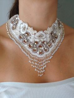 Necklace | Paula Higa.   The base is a Brazilian white lace, all embroidered with Swarovski crystals and pearls, Austrian rhinestone, seed beads, and cabochons