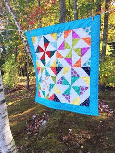Handmade baby quilts are one of the best gifts you can give as a baby shower gift. Sew Happy Quilting has unique quilts for baby girls and baby boys. Baby quilts are washable and are wonderful heirloom gifts that can be passed from generation to generation. Check out sewhappyquilting.com today. #babyquilt #babygirlquilt #babyboyquilt #babyshowergift #uniquebabygift #heirloomgift #babyblanket #nurserydecor #cribquilt Unique Baby Shower, Baby Shower Gifts, Handmade Baby Quilts, Baby Girl Quilts, Unique Baby Gifts, Triangle Pattern, Green Fabric, Baby Room Decor, Pinwheels