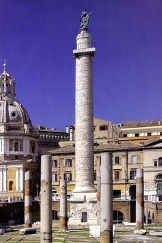 Column of Trajan. Similar in construct to the Column of Marcus Aurelius. Today there is a statue of St. Peter on top. Dedicated AD 113. 125 ft. tall, including the base. This is the only column in which an emperor was probably buried.