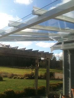 Our expertise is in custom glass canopy designs and installations. With many shapes and styles to choose from, visit our website today for glass canopy ideas. Small Pergola, Pergola With Roof, Cheap Pergola, Pergola Shade, Patio Roof, Gazebo, Pergola Ideas, Covered Decks, Covered Pergola