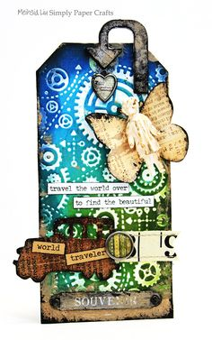 Meihsia Liu simply paper crafts mixed media tag world traveler simon says stamp tim holtz 0
