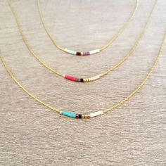 Minimalist Gold Delicate Short Necklace with Tiny Beads // Thin Layering Necklace // Colorful & Simple Boho Necklace(Etsy のKurafuchiより) https://www.etsy.com/jp/listing/240230866/minimalist-gold-delicate-short-necklace