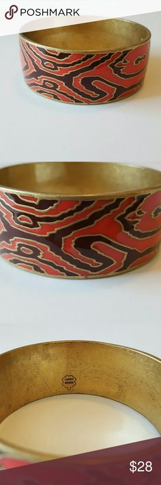 Lucky Brand Tribal Bangle Lucky Brand bangle. Never worn. Coral and purplish brown tones with brass trim. Brass has a worn look on the inside. See 3rd and 4th photos. Outside enamel in perfect condition. Jewelry Bracelets