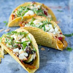 Vegetarian Tacos with Spicy Crema Recipe Main Dishes with taco shells, taco seasoning, yellow bell pepper, mushrooms, onions, zucchini, yellow squash, olive oil, salt, pepper, queso fresco, cilantro, lime, romaine lettuce, crema, chili powder, cumin