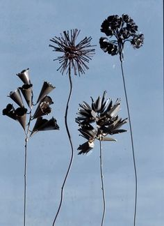 I don't know why I am drawn to gray steel flowers but I am.  They might look good mixed with my copper enameled flowers.