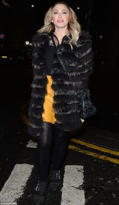 Winter chic: The former Atomic Kitten star proved why she caught the fashion executive's eye in a chic mustard skirt and faux-fur jacket