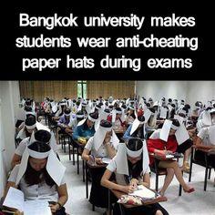 Bangkok university makes students wear anti-cheating paper hats during exams