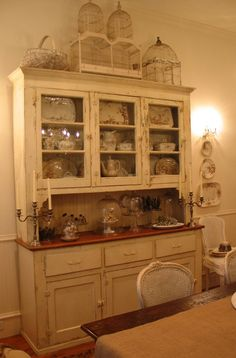 I have the perfect place in my kitchen for an old dining hutch like this...  dear garage sales, please have one waiting for me next summer :)