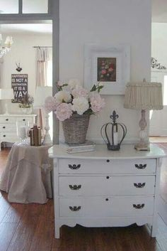 .White dresser w/basket of flowers, candle and lamp