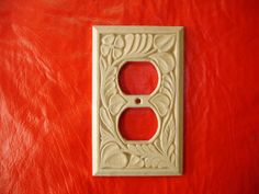Hand carved electric outlet cover plate by creativemind44 on Etsy, $22.00