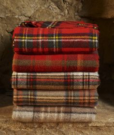 Traditional Tartan Throw Blanket. Top Quality * British Made * Pure New Wool Great as a picnic blanket or for barbecues, beach, camping or sports events Ideal as a furniture throw for any chair or sofa Keeping you warm and cosy when reading or watching TV, or just napping! Lovely warm all wool throw rugs perfect for any outdoor trip The traditional car travel rug Ideal Scottish gifts in your family tartan. Measuring approx 140cm x 180cm with a rolled fringe. Weight approx 1kg.