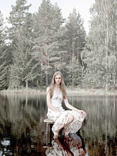 Bench or chair in a lake or pond (or stream or waterfall). (Nygards Anna)