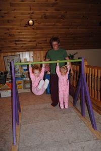 homemade gymnastics bar.  Visit pinterest.com/arktherapeutic for more #grossmotor ideas