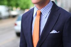 Navy Suit, Blue Gingham Shirt Pocket Square, Orange Tie. Coral tie + checked blue shirt? Too casual with the checks? To crazy with the coral tie? Would be festive. - TOBIAS.