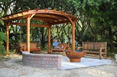 Bench Swings (Options: Large Garden Bench, Redwood, Classic Design Seat, No Engraving, All Beam Hanging Hardware, Transparent Premium Sealant). Photo Also Shows an Arched Pergola and a Ti Amo Bench. Photo Courtesy of Tom Marten of Kitty Hawk, NC.