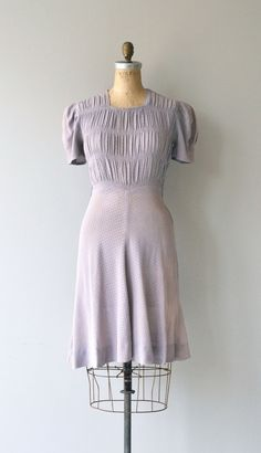 Vintage 1930s lavender woven rayon dress with short sleeves, shirred bodice, fitted waist, short kicky skirt and metal side zipper. --- M E A S U R E M E N T S --- fits like: small/medium shoulder: 17 bust: up to 40 waist: up to 29 hip: up to 38 length: 40 brand/maker: n/a condition: great, some very faint underarm discoloration, easily unnoticed. ✩ layaway is available for this item To ensure a good fit, please read the sizing guide: http://www.etsy.com/shop/DearGolden/policy ✩ more vint...