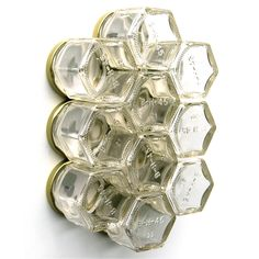 Use these 10 hexagonal jars to store your seasonings on your fridge or any steel surface. This spice rack saves valuable cabinet space in cramped apartments. $43 fab.com  but i am going to see if I can make it myself... tired of looking for spices in the cupboard!