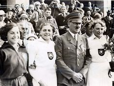 Berlin, 1936: Adolf Hitler with German athletes during the Olympic torch relay