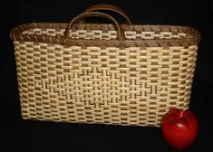 "2a_brinkman_appdiamond.jpg (500×358) Sturdy, rustic basket woven with smoked reed and binder cane, basket features a diamond pattern woven on both sides and wrapped handles. Special attention is given to shaping and weaving with binder cane. 15"" L x 10"" H x 5"" W"