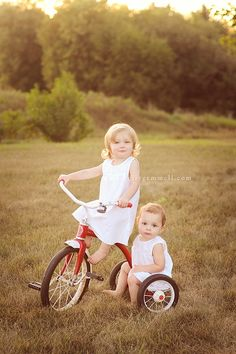 This is such a precious picture. Big sister taking little sister for a ride. Perfect for their bedroom.