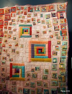 "This quilt called ""iro-iro Colors"" by Akiko Fukui was purposely ""warped"" with all sizes of colorful log cabin blocks and wobbly edging. 2016 Tokyo International Great Quilt Festival. Photo By Taniwa."