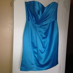 """David's Bridal Malibu Blue Dress Satin dress in """"Malibu Blue"""" from David's Bridal. Beautiful dress, wore it once as a bridesmaid in a wedding. Dress is too big on me now so that's why I'm getting rid of it. Would be perfect to wear to a wedding (as a bridesmaid or not) or another special event. Size 12, great condition. David's Bridal Dresses"""