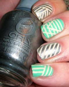 Summerella -- Tribal nail art design using striping tape -     Polishes used: OPI My Vampire Is Buff, Essie First Timer and Orly Shine