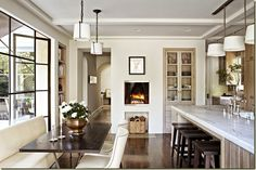 interesting getting the dark contrast from furniture and floors, but not counters or cupboards