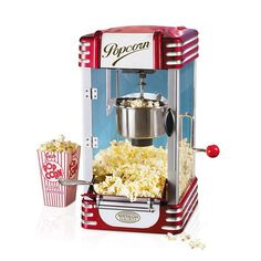12 Wedding Registry Items for an At-Home Date Night | When you don't want to go to the theater, bring it to your home. Movie night isn't the same without the staple movie theater snack, courtesy of an old-fashioned popcorn machine.