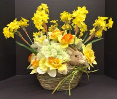 Easter 2015 Floral: Daffodil Straw Bunny Basket with raffia green bow. Original design and arrangement by http://nfmdesign.synthasite.com/
