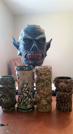 The first BonesArt latex mask, with Andrew's tiki mug collection, including out Innsmouthfogcutter and Cthulhu Tiki Mug