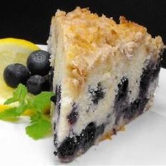 I have altered my grandmother's famous blueberry cake recipe to my personal liking. The toasted coconut crumble topping is a wonderful addition to the cake.