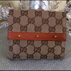 AUTHENTIC GUCCI FRENCH FLAP WALLET Gently used GUCCI wallet.  Brown canvas/British tan leather.  Leather interior with 10 card slots, 2 bill compartments, outside snap coin compartment.  There is some minor wear on the corners of the leather on the coin flap.🚫NO TRADES🚫PAYPAL Gucci Bags Wallets