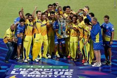 Chennai Super Kings with the trophy celebrating their victory during The Final of the Oppo Champions League Twenty20 between the Kolkata Knight Riders and the Chennai Super Kings held at the M. Chinnaswamy Stadium, Bengaluru, India on the 4th October 2014