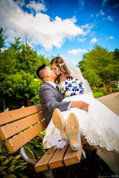 Kissing bride and groom on wooden park bench during a beautiful summer day #Michiganwedding #Chicagowedding #MikeStaffProductions #wedding #reception #weddingphotography #weddingdj #weddingvideography #wedding #photos #wedding #pictures #ideas #planning #DJ #photography #bride #groom