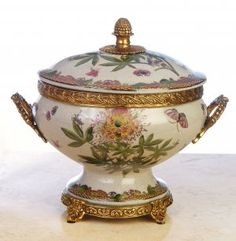 PORCELAIN JAR WITH LID AND BRASS Beautiful antique style, hand painted green floral, butterfly and birds, Intricately carved brass trim, handles, base and handle on lid, Porcelain has a crackled finish