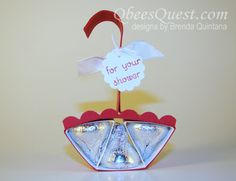 We are approaching June, one of the most popular wedding months, so I thought it would be a great time to introduce a Hershey's Shower Umbrella. This is one of my simplest Hershey's designs to date an Baby Shower Crafts, Baby Shower Favors, Candy Crafts, Paper Crafts, Chocolates, Umbrella Cards, Hershey Kisses, Hershey Nugget, Hershey Candy