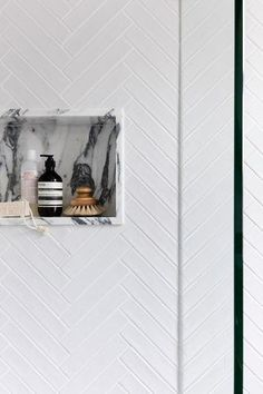 White subway chevron tile in sho with marble soap niche accent. House Bathroom, Bathroom Styling, Marble Bathroom, Bathroom Interior Design, Bathroom Decor, Herringbone Tile Bathroom, Tile Bathroom, Shower Tile, Shower Wall