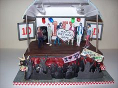 Best One Direction cake I've seen. The stage lights up and even the camera in the audience has a viewfinder! :)
