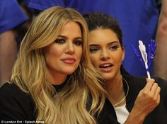 Do you see what I see? Khloe and Kendall chatted jovially as they took in all of the basketball action