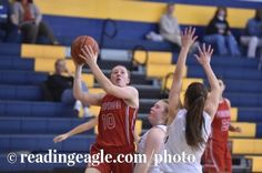 Fleetwood's Rebekah Earnest (10) goes to shoot against Muhlenberg's Taylor Wilson (31). Girls Basketball, the Fleetwood Tigers vs. the Muhlenberg Muhls at Muhlenberg High School Thursday evening January 12, 2017. Fleetwood won 40-33. Photo by Ben Hasty