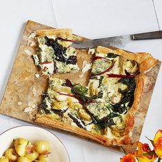 Using ready-rolled puff pastry and artichokes from a jar makes this vegetarian chard, artichoke and blue cheese tart incredibly quick to prepare.