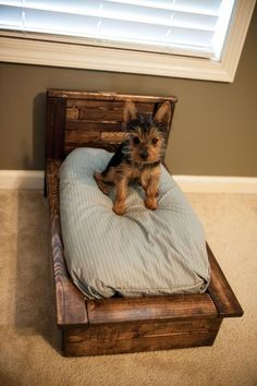 Pallet wood dog bed. So simple and adorable. Much better looking than your standard dog bed pillow on the floor.