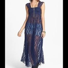 Free People Romance In The Air Lace Slip Dress Sheer lace lends beguiling beauty to Free People's romance-worthy slip dress. Nylon/spandex. Machine wash. Imported. Square neck, sleeveless, pullover style. Semi-sheer, lining slip not included.  Color:  Navy.  An effortless and romantic layering staple.   *92% Nylon  *8% Spandex  *Machine Wash Cold  *Import Free People Dresses