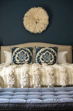 I never tire of Moroccan wedding blankets on beds. So many pretty ones like this in www.redthreadsouk.com